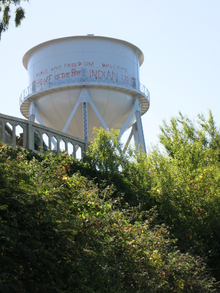 Traces of the American Indian occupation can be seen across the island - in this case painted on the water tower
