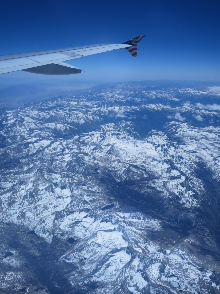 Flying over snowy mountain peaks