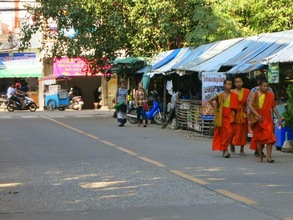 Monks walking along the street