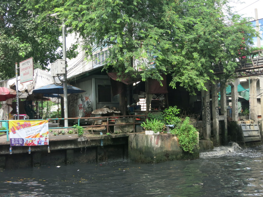 Houses and shops line the canal