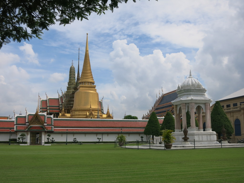 The chedi of Wat Phrakaew standing above the wall